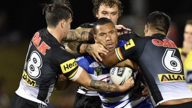 In the thick of the action: Asipeli Fine takes on the Panthers in round eight of last season.