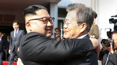 Kim Jong-un, left, and Moon Jae-in embrace after their meeting on May 26.