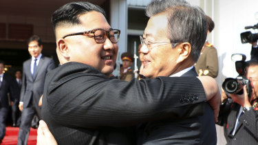 Kim Jong Un, left, and Moon Jae-in embrace each other after their meeting on May 26.