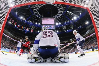 TOPSHOTS Forward Jordan Eberle (2nd L) shoots to score past goalkeeper Ronan Quemener of France during the group A preliminary round match France vs Canada at the 2015 IIHF Ice Hockey World Championships on May 9, 2015 at the O2 Arena in Prague. Canada won the match 3-4. AFP PHOTO / JONATHAN NACKSTRAND