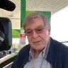 At a servo on the road to Sydney, Pell says he's 'very pleased' to be free