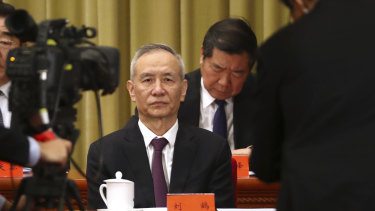 Chinese Vice Premier Liu He, centre, attends an event to commemorate the 40th anniversary of the Message to Compatriots in Taiwan at the Great Hall of the People in Beijing.