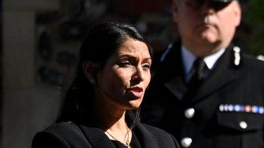 British Home Secretary Priti Patel speaks to the media on Monday.
