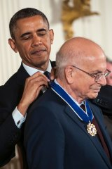 President Barack Obama presents the Presidential Medal of Freedom to psychologist Daniel Kahneman at a ceremony held at the White House on Nov. 20, 2013.