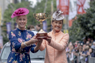 Lord mayor Sally Capp with VRC chairman Amanda Elliott holding the $200,000 Cup during the parade.