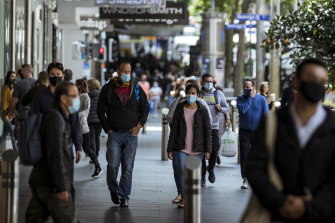 Pedestrians walk along Bourke Street on Melbourne's first post-lockdown weekend. Victoria led the country on financial and mental distress at the end of its 15-week lockdown.