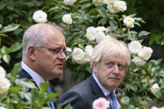 Prime ministers Scott Morrison and Boris Johnson walk to their joint press conference in the Downing Street garden.