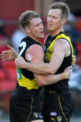 Tigers duo Riewoldt (right) and Caddy had a field day, kicking 14 goals between them.