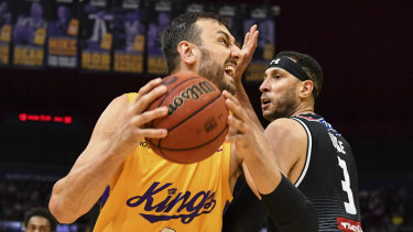 Andrew Bogut competing for possession with Melbourne's Josh Boone last season.