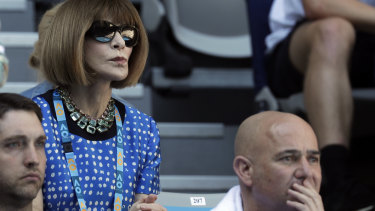 Power play ... Anna Wintour watches the Australian Open behind tennis legend Andre Agassi on Sunday.