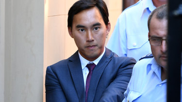 Kevin Ly is escorted from the NSW Supreme Court on Monday.