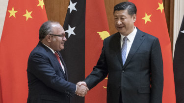 PNG leader Peter O'Neill meets China's President Xi Jinping in Beijing earlier this year.
