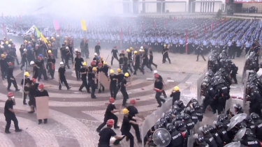 A simulated protest in front of 12,000 Chinese mainland police doubles as a stark warning to protesters in neighbouring Hong Kong.