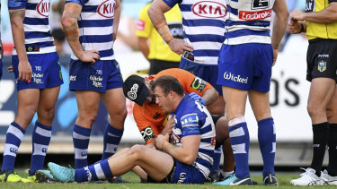High elbow: Josh Morris stays down after a collision with Sam Burgess.