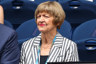 Margaret Court and her husband take in the tennis on day one of the Open.