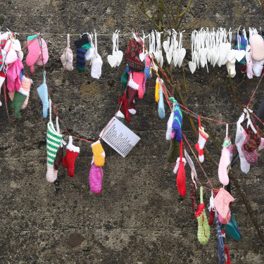 Children's socks line a grotto on an unmarked mass grave at the site of the Tuam Mother and Baby Home, which closed in 1961.