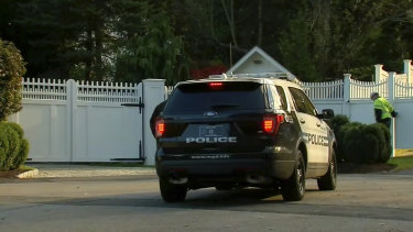 A police car sits outside the home of Bill and Hillary Clinton on Wednesday.