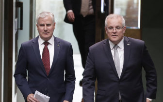 Michael McCormack and Scott Morrison say increased climate action will lead to 'higher taxes and higher electricity prices'.