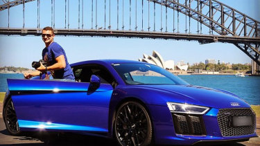 Anthony Koletti with the Audi that has been repossessed.