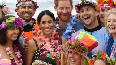 Britain's Prince Harry, the Duke of Sussex and his wife Meghan, the Duchess of Sussex, on Bondi Beach on Friday.