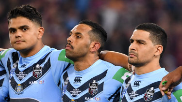 NSW stars Latrell Mitchell, Josh Addo-Carr and Cody Walker during the anthem before the State of Origin last year.