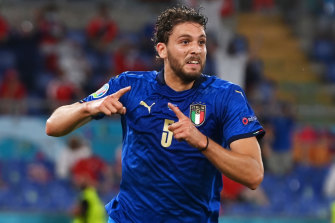 Manuel Locatelli celebrates the first of his two goals for Italy against Switzerland.