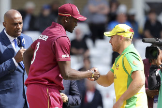 Aaron Finch and Jason Holder in 2019.