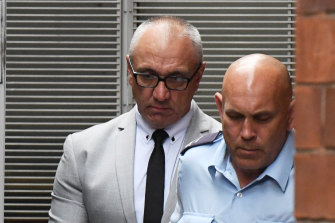 Michael Meakin, left, is taken from the NSW Supreme Court in Sydney on Friday.