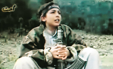 A photo taken from a film of Hamza bin Laden during terrorist training in the Afghanistan-Pakistan border area. His age at the time is unknown.