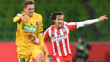 Simply Brillante: Central Coast's Gianni Stensness gives chase as City midfielder Josh Brillante surges forward.