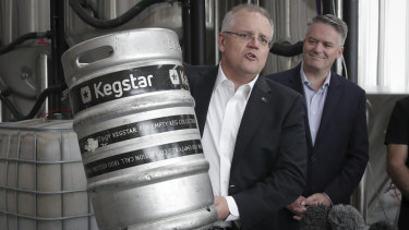 Treasurer Scott Morrison flanked by Finance Minister Mathias Cormann announces changes to beer taxes on Friday.