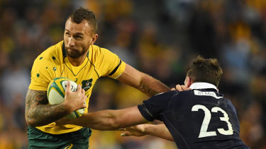Back to the future: Quade Cooper fends off Scotland's Matt Scott at Allianz Stadium in 2017.