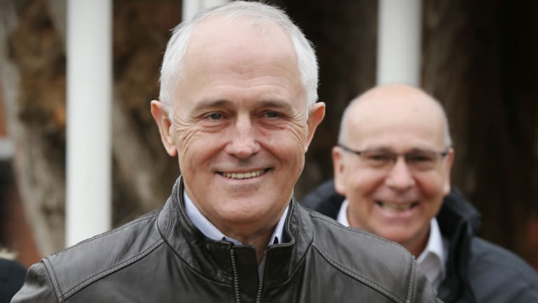 Prime Minister Malcolm Turnbull, with Andrew Goodwin in the background, on a visit to SMEC in Cooma on Wednesday 28 June 2017.