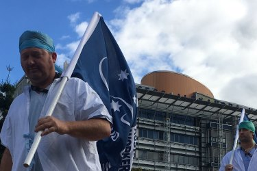Workers strike outside Brisbane's Princess Alexandra Hospital on Friday afternoon over the state government's planned public service wage freeze