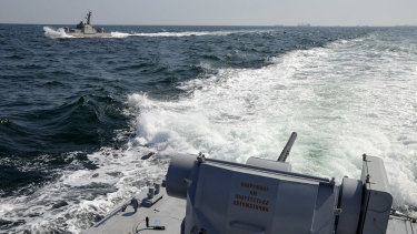 The Ukrainian navy says a Russian coast guard vessel rammed a Ukrainian navy tugboat near Crimea, damaging the ship's engines and hull.