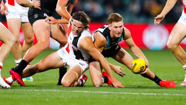 Winning ways: Hunter Clark scrambles with Port's Kane Farrell during St Kilda's upset round 8 victory at Adelaide Oval.