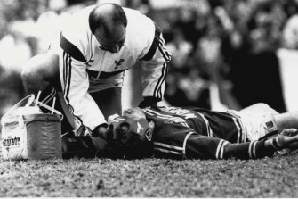 Ron Gibbs is attended to by a trainer after being knocked out playing for Manly in 1987.