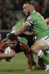 Josh Hodgson makes a tackle on Sam Burgess during Canberra's preliminary final win.