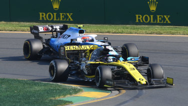 Promising signs: Australia's Daniel Ricciardo overtakes through turn one, before his Renault was forced to retire from the race.