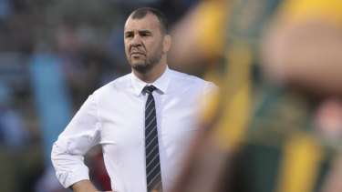 Spray: Michael Cheika was seen giving the players a serve at halftime.
