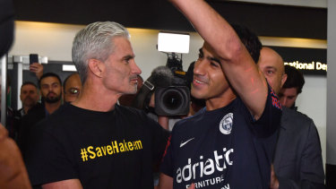 A jubilant Hakeem al-Araibi arrives home from captivity in Thailand on February 12 to be greeted by former Socceroo Craig Foster.