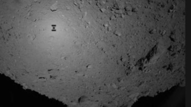 The shadow (centre left) of Japanese unmanned spacecraft Hayabusa 2 can be seen over the asteroid Ryugu.