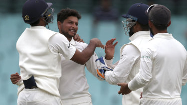 The Indian team celebrates another Australian wicket in Sydney.