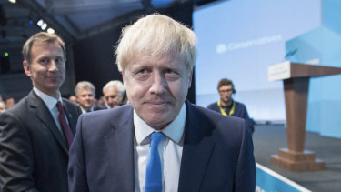 Boris Johnson makes his way to the stage after the announcement of the winner of the Conservative Party leadership.
