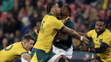Defensive wall: South Africa's Warrick Gelant runs into Lukhan Salakaia-Loto at Ellis Park.