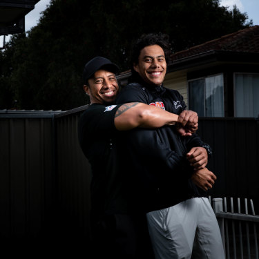 Martin Luai, who was released from prison in April, with his son Jarome at the front of their Dharruk home.