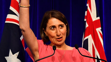 NSW Premier Gladys Berejiklian celebrates victory on Saturday night.