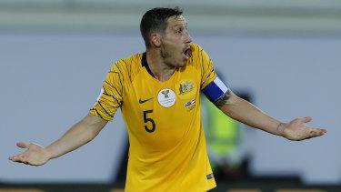 Injury: Socceroos midfielder Mark Milligan.