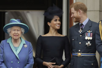 Queen Elizabeth II, with Meghan and Prince Harry in 2018. The Sussexes insist they rang the Queen to ask her about their daughter's name shortly after the birth.