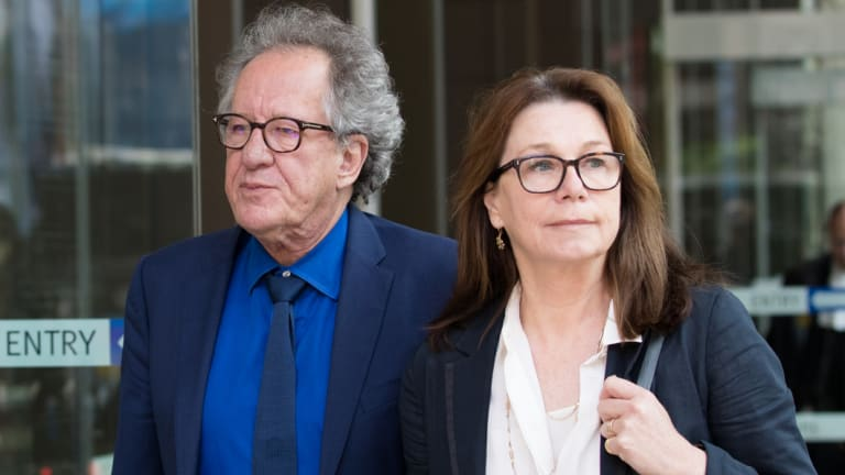 Geoffrey Rush with his wife, Jane Menelaus, leave the Supreme Court on the final day of his defamation case against News Corp